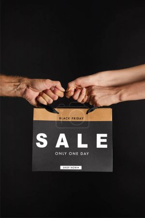 Photo for Partial view of woman and man holding paper shopping bag with sale only one day illustration isolated on black, black Friday concept - Royalty Free Image