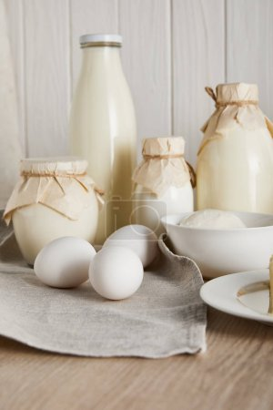 delicious fresh dairy products and eggs on white wooden background