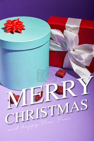 Photo for Blue and red gift boxes near baubles on purple background with Merry Christmas and happy new year illustration - Royalty Free Image