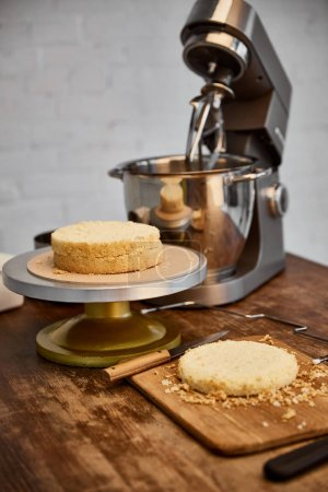 Photo for Table with cooking utensils and sponge cake - Royalty Free Image