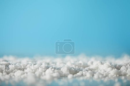 Photo pour Decorative snow on blue for christmas background - image libre de droit