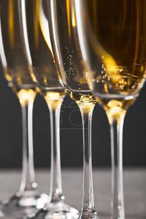 Foto de Close up of sparkling wine in glasses on grey - Imagen libre de derechos