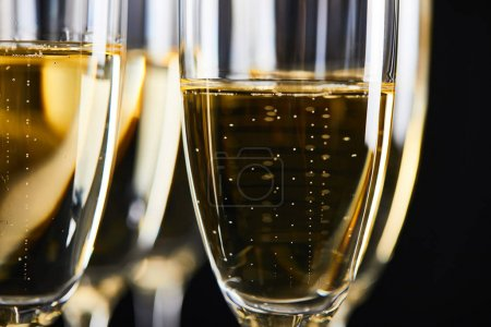 Photo for Close up of sparkling wine in glasses for celebrating christmas, isolated on black - Royalty Free Image