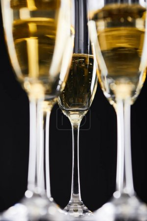 Photo for Glasses of sparkling wine for celebrating christmas, isolated on black - Royalty Free Image