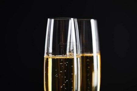 Photo for Close up of champagne in glasses for celebrating christmas, isolated on black - Royalty Free Image