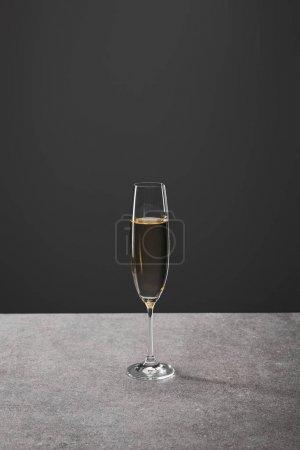 Photo for One glass of sparkling wine for celebrating christmas on grey - Royalty Free Image