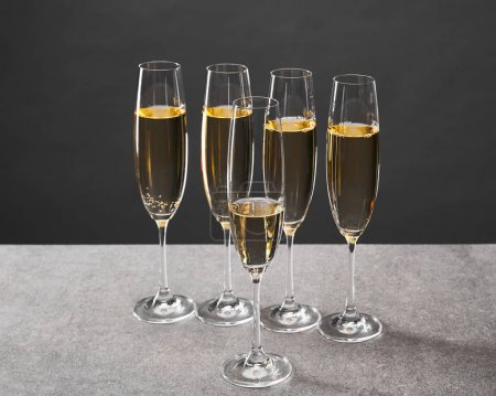 Photo for Champagne in glasses for celebrating christmas eve on grey - Royalty Free Image
