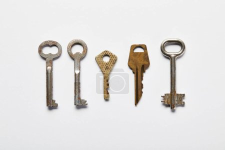 Photo for Flat lay with vintage rusty keys on white background - Royalty Free Image