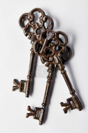 Photo for Top view of vintage keys on white background - Royalty Free Image