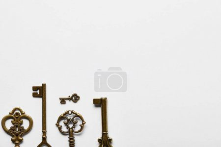 Photo for Top view of retro keys on white background with copy space - Royalty Free Image