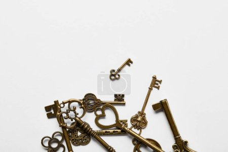 Photo for Top view of vintage keys in stack on white background - Royalty Free Image
