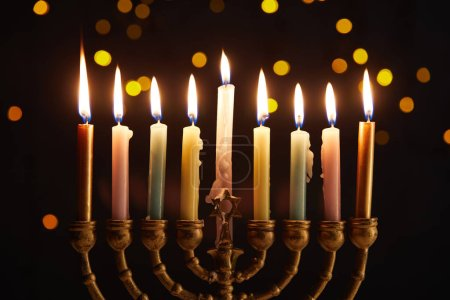Photo for Burning candles in menorah on black background with bokeh lights on Hanukkah - Royalty Free Image