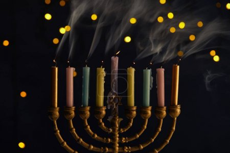 Photo for Candles in menorah on black background with bokeh lights on Hanukkah - Royalty Free Image