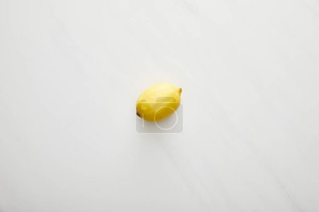 Photo for Top view of fresh lemon on marble background - Royalty Free Image