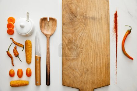 Photo for Top view of kitchenware with vegetables and chili pepper spice on marble background - Royalty Free Image