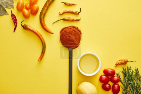 Photo for Top view of chili peppers with rosemary, vegetables and spices on yellow background - Royalty Free Image