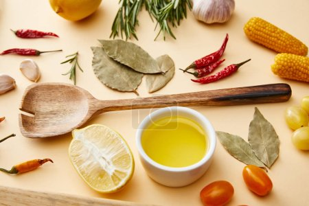 Photo for Olive oil with organic vegetables and rosemary on beige background - Royalty Free Image