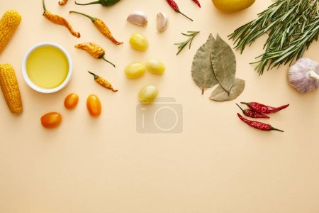 Photo for Top view of vegetables, olive oil and rosemary on beige background - Royalty Free Image