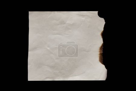 Photo pour Top view of empty burnt vintage paper isolated on black - image libre de droit