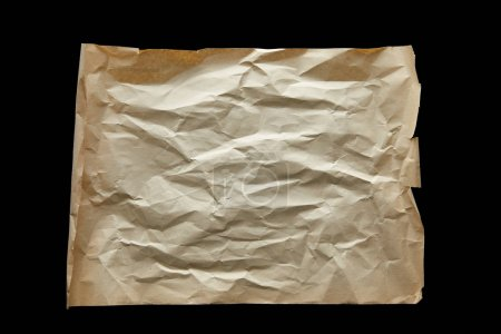 top view of empty crumpled vintage paper isolated on black
