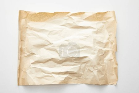 Photo for Top view of empty crumpled vintage paper on white background - Royalty Free Image