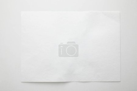 Photo for Top view of empty paper on white background - Royalty Free Image