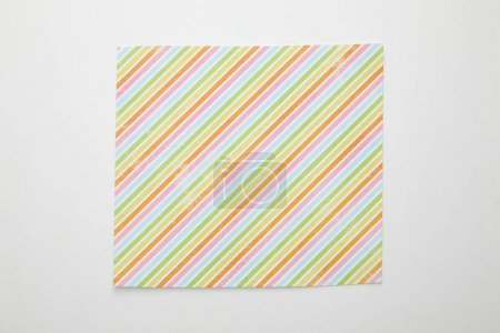 Foto de Top view of empty crumpled and burnt paper with colorful lines on white background - Imagen libre de derechos