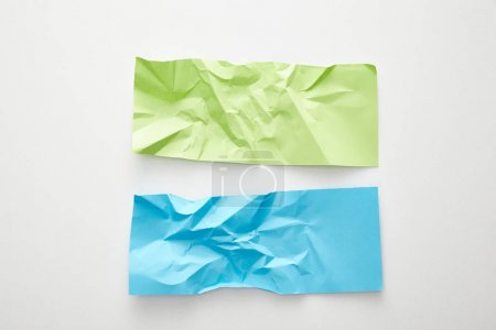 Photo for Top view of empty crumpled blue and green paper on white background - Royalty Free Image