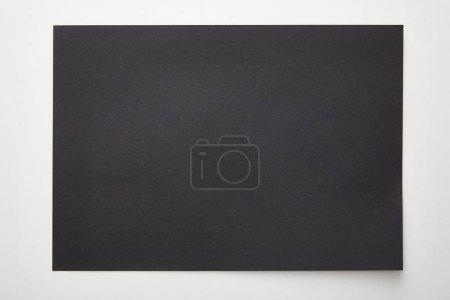 Foto de Top view of empty black paper on white background - Imagen libre de derechos