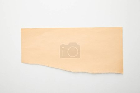 Photo for Top view of empty orange paper on white background - Royalty Free Image