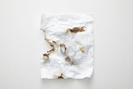 Photo for Top view of empty crumpled and burnt vintage paper on white background - Royalty Free Image