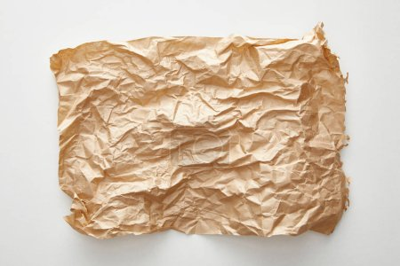 Photo for Top view of empty crumpled craft paper on white background - Royalty Free Image
