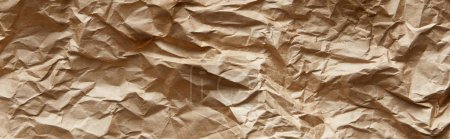 Photo pour Top view of empty beige crumpled craft paper texture, panoramic shot - image libre de droit