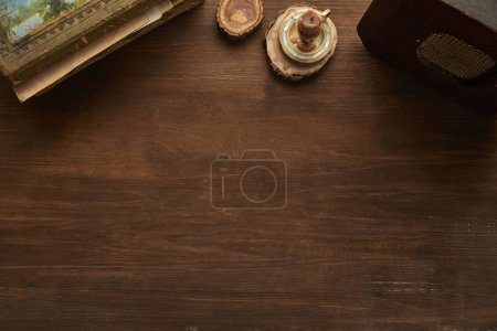 Photo for Top view of vintage painting, candle and old radio on wooden table - Royalty Free Image