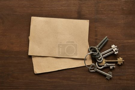 Photo for Top view of vintage paper and keys on wooden table - Royalty Free Image