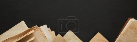 Photo for Top view of vintage paper on black background, panoramic shot - Royalty Free Image