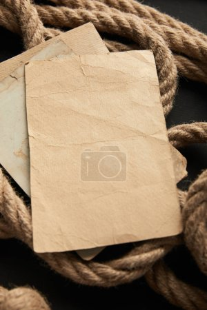 Photo for Vintage paper on rope on black background - Royalty Free Image