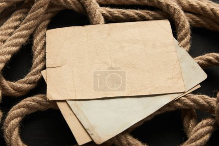 Photo for Vintage paper and rope on black background - Royalty Free Image