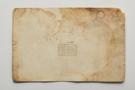 Photo for Top view of vintage dirty beige paper on grey background - Royalty Free Image
