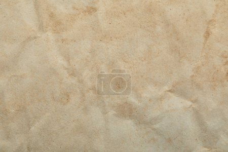 Photo pour Top view of crumpled vintage beige paper texture with copy space - image libre de droit