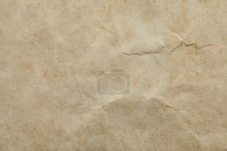 Photo for Top view of crumpled vintage beige paper texture with copy space - Royalty Free Image