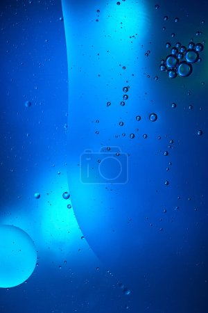 creative abstract blue color background from mixed water and oil