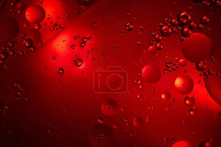 Beautiful red color abstract background from mixed water and oil bubbles