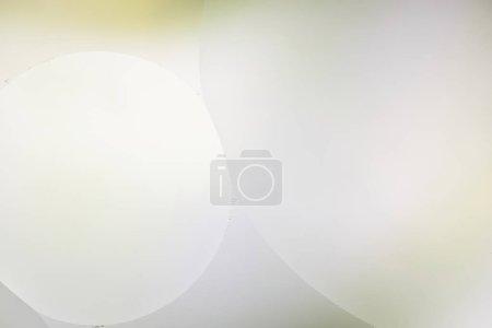 Photo pour Arrière-plan abstrait d'un mélange d'eau et d'huile en vert clair et gris - image libre de droit