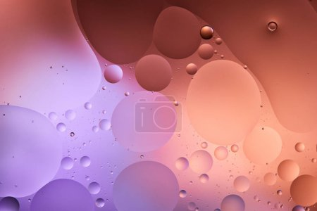 creative abstract purple and pink color texture from mixed water and oil bubbles