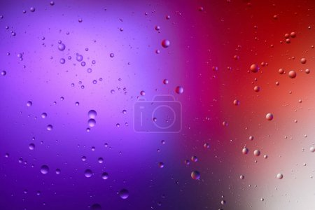 Photo pour Couleur violette et rouge fond abstrait de mélanges de bulles d'eau et d'huile - image libre de droit