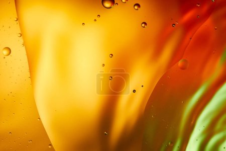 abstract orange, red and green color background from mixed water and oil