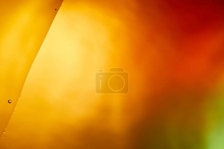 Beautiful orange, red and green color background from mixed water and oil