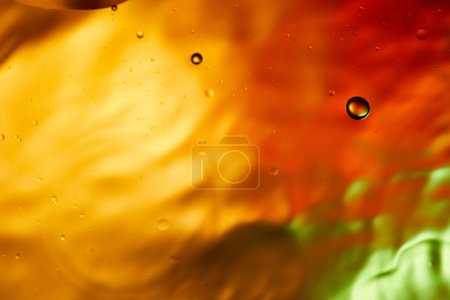 Photo for Beautiful abstract orange, red and green color background from mixed water and oil - Royalty Free Image