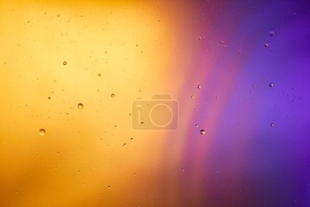 abstract orange and purple color background from mixed water and oil